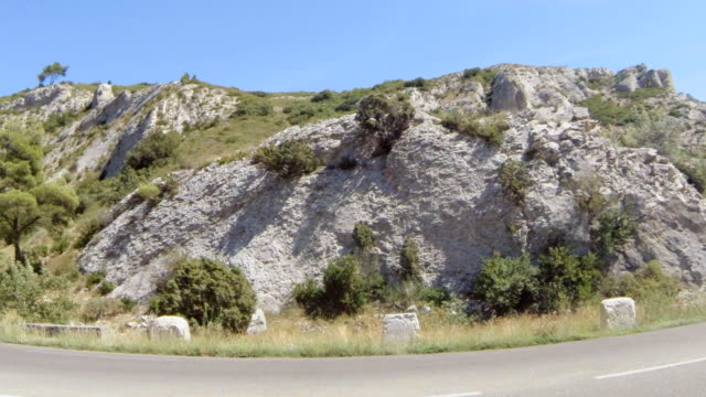 MS Shot of cliff beside road / St. Remy de Provence, Provence, France