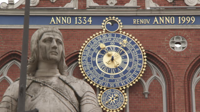 MS Shot of Clock and Statue / Riga, Latvia