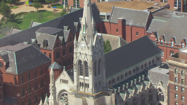 ms aerial ts zo shot of clock bell tower of st francis xavier college church / st louis, missouri, united states - st. louis missouri stock videos & royalty-free footage