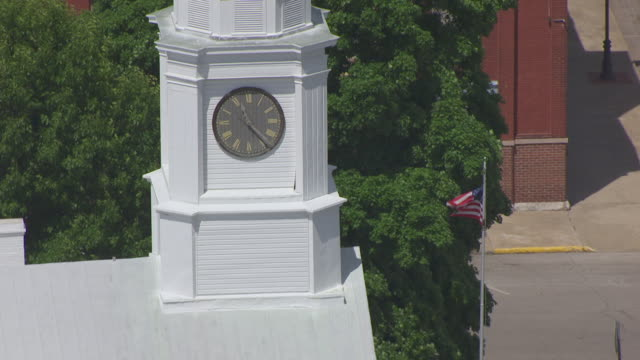 CU AERIAL ZO Shot of clock tower at Lafayette County Courthouse / Missouri, United States