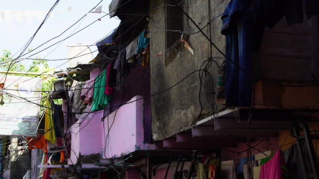 a shot of clothes draped around a home in india - slum stock videos & royalty-free footage