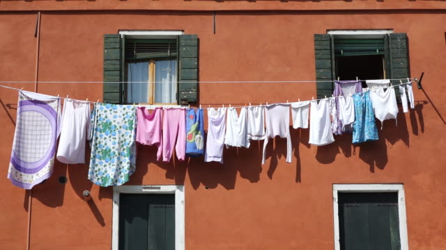 WS Shot of clothes hang to dry at front of house in Arsenale / Venice, Veneto, Italy
