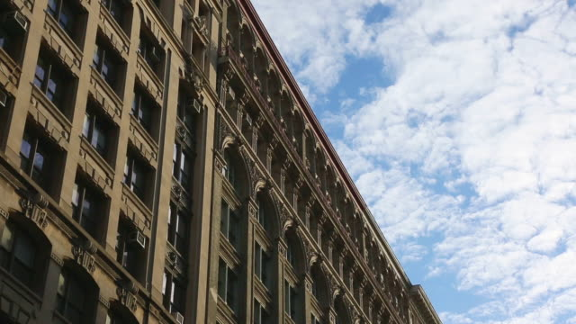 ms t/s shot of cloud migrating over soho loft buildings / new york, united states - loft apartment stock videos & royalty-free footage