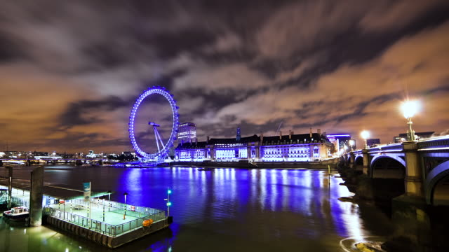 ms t/l shot of clouds moving over of london eye at evening / london, united kingdom - millennium wheel stock videos & royalty-free footage