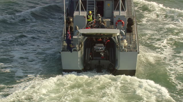 cu aerial zo shot of coast guard ready for rescue operation leaving customs patrol craft / suffolk, france - 救助隊点の映像素材/bロール
