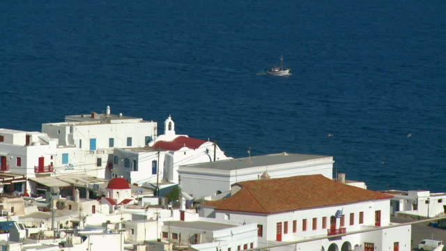 ms shot of coastal town / mykonos, cyclades, greece - medium group of animals stock videos & royalty-free footage