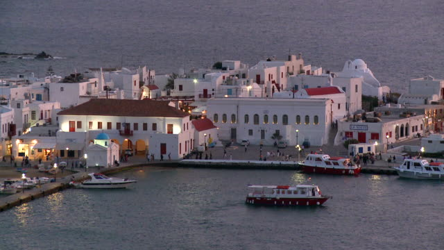 ms shot of coastal town near beach at night / mykonos, cyclades, greece - mykonos stock videos and b-roll footage