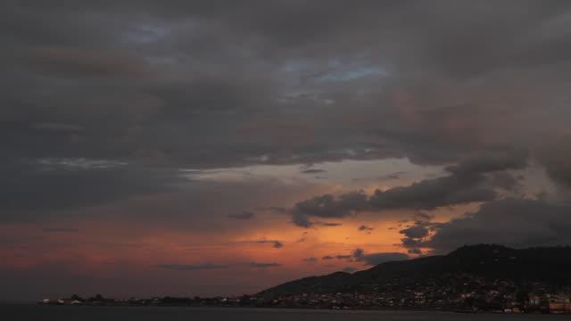 ws pan shot of coastline at sunset / freetown, sierra leone - sierra leone stock videos & royalty-free footage