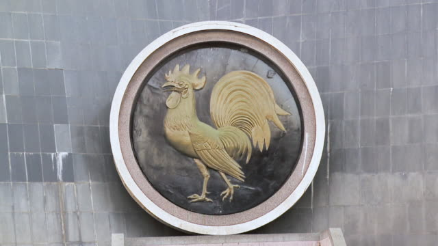 CU Shot of cockerel rooster emblem on wall / Nairobi, Kenya