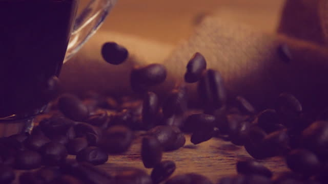 slo mo shot of coffee beans - bag stock videos & royalty-free footage