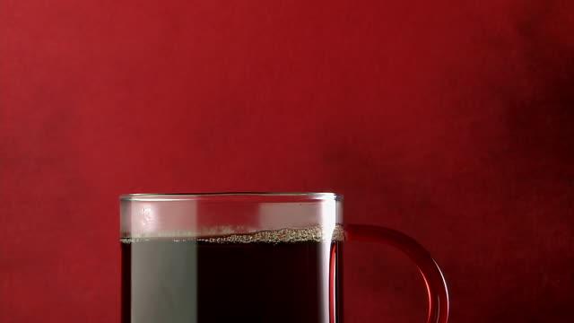 ms shot of coffee/tea poured into cup / estepona,espana, malaga, spain   - coffee cup stock videos & royalty-free footage