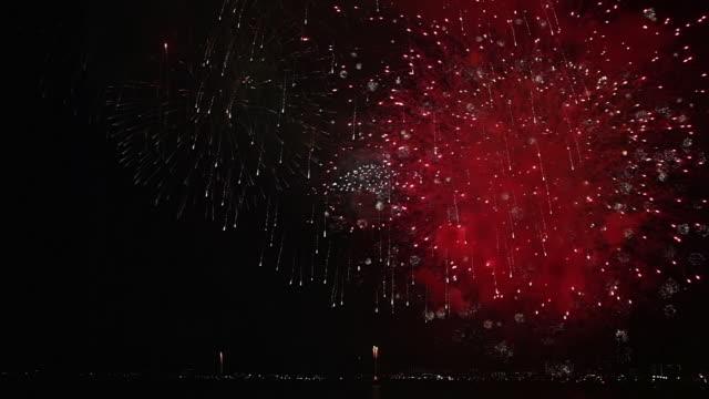 WS Shot of Collage of fireworks over city at night / Yokosuka, Tokyo, Japan