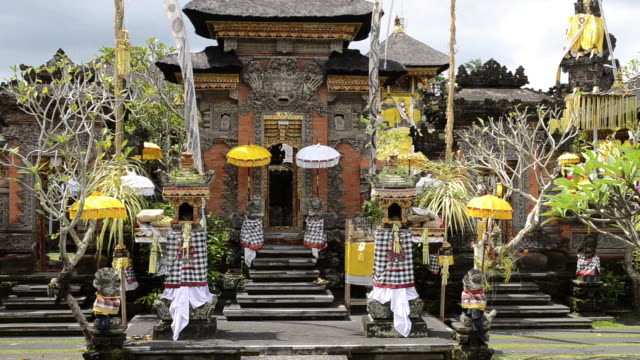 ms shot of colorful decorated pura dalem puri temple with umbrellas / ubud, bali, indonesia - indonesia travel stock videos & royalty-free footage