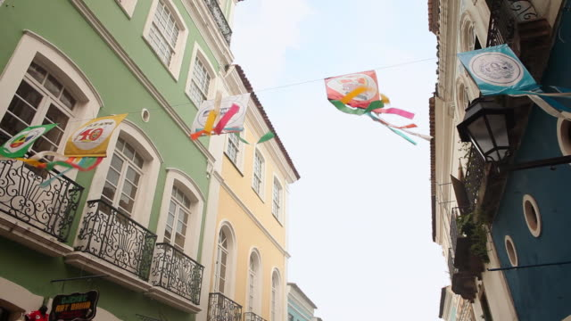 MS LA Shot of Colorful decorations blowing in wind on street / Salvador, Bahia, Brazil