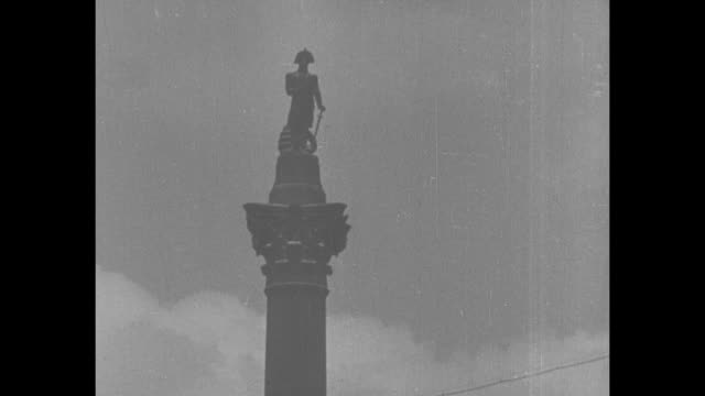 shot of column with statue of adm horatio nelson at top / closer shot of statue of nelson at top of column / repair work at base of column tilt up... - nelson's column stock videos & royalty-free footage