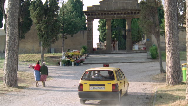 ms zi  shot of columned entrance of cemetery - 1992 stock-videos und b-roll-filmmaterial