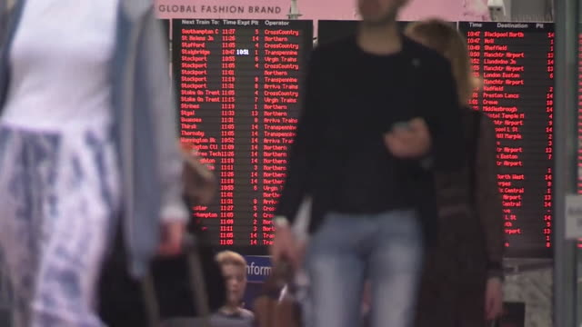 shot of commuters in front of the departure board at manchester piccadilly train station - bulletin board stock videos and b-roll footage