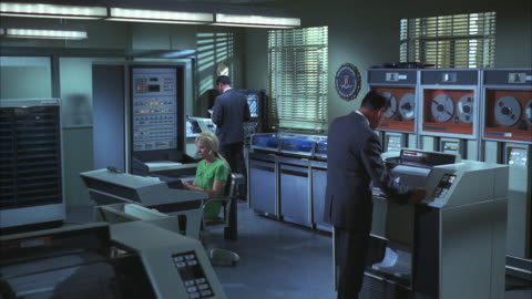 ms shot of computer operators working at ncic computer room  - fbi stock-videos und b-roll-filmmaterial
