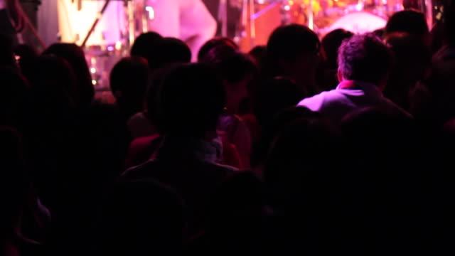 MS PAN Shot of concert crowd hands up and jumping / Ebisu, Tokyo, Japan