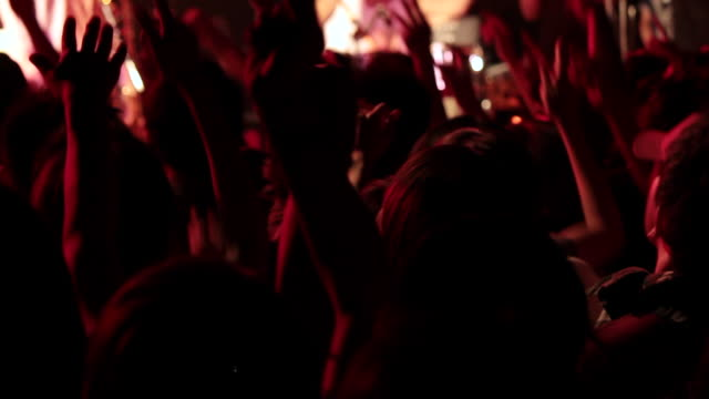 ms pan shot of concert crowd hands up and jumping / ebisu, tokyo, japan - 若者文化点の映像素材/bロール
