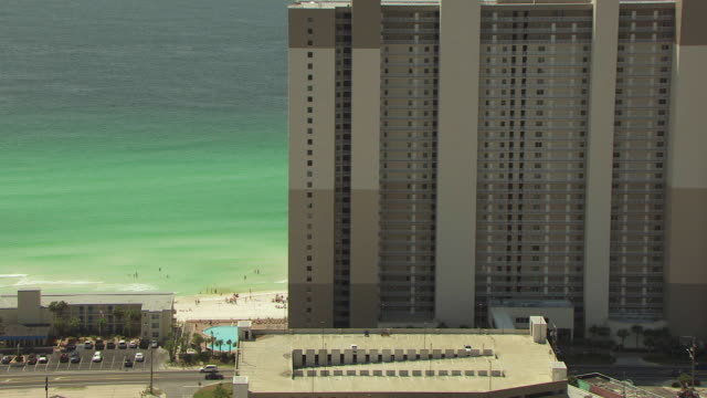 WS AERIAL ZI Shot of condos and hotels with spring breakers on beach / Panama City, Florida, United States