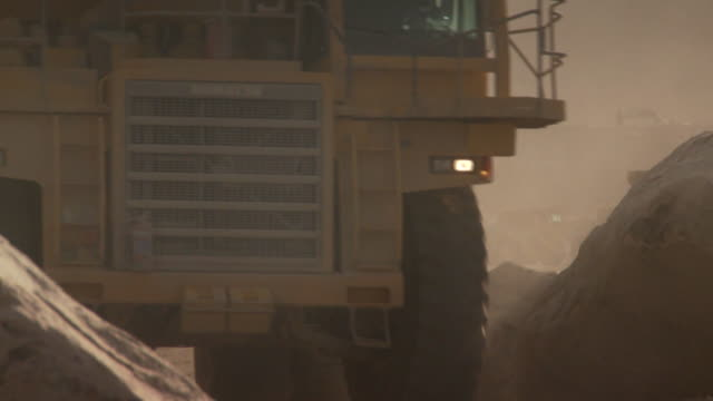 cu shot of construction vehicle approaching / namibia - mining stock videos & royalty-free footage