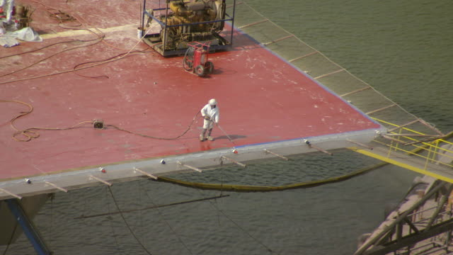 MS AERIAL ZO TS Shot of construction worker repairing oil platform at port fourchon / Louisiana, United States