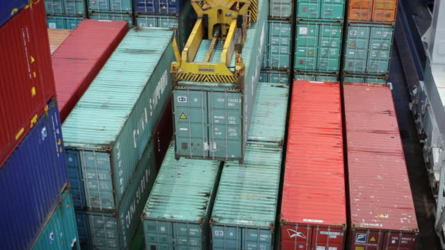 MS Shot of container being loaded on cargo ship (night) / Gothenburg, Västergötland, Sweden