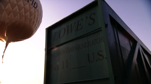Ms Pan Shot Of Container Saying Lowes Balloon Gas Generator