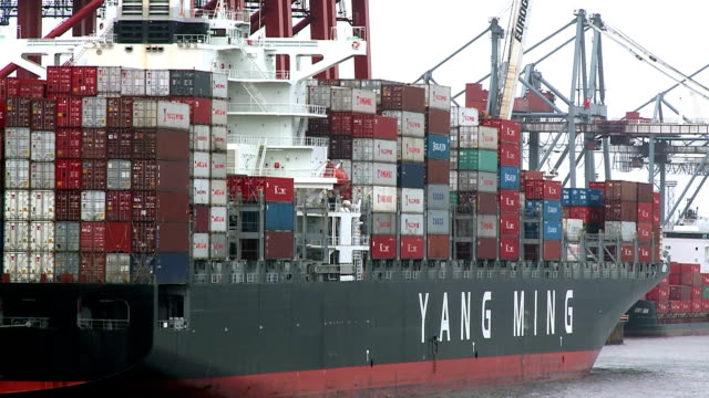 ws shot of container ship in harbour / hamburg, germany  - western script stock videos & royalty-free footage