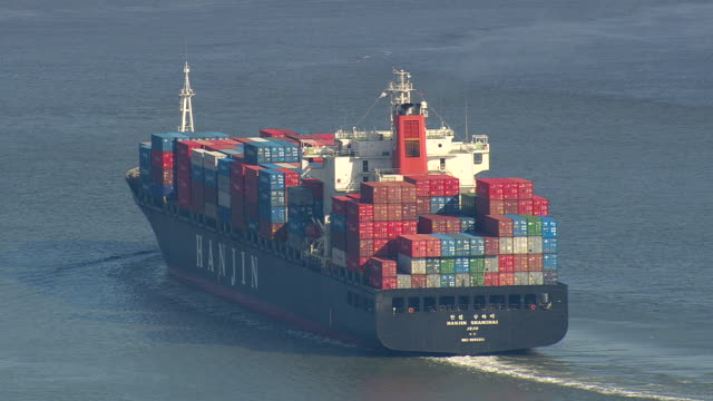 ms aerial zo shot of container ship moving near bald head island / north carolina, united states - bald head island stock videos and b-roll footage