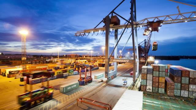 WS T/L Shot of container terminal from cargo ship (dusk) / Hamburg, Hamburg, Germany