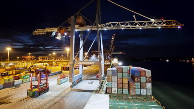 MS T/L Shot of Container terminal from cargo ship (dusk) / Hamburg, Hamburg, Germany
