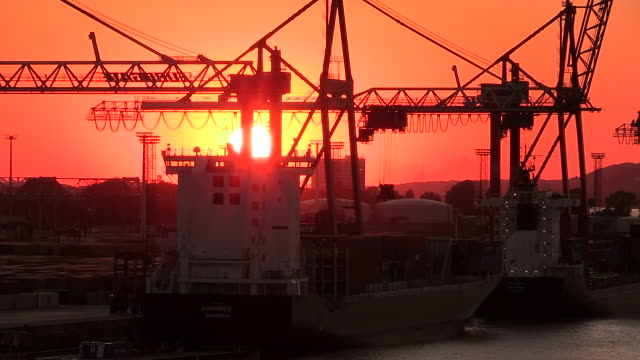 ms shot of container terminal with trolley in harbour at sunset / hamburg, germany - dramatic sky stock videos & royalty-free footage