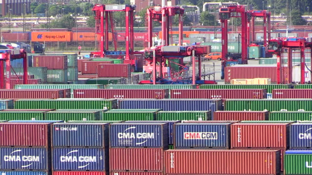 ms shot of container terminal with trolley in harbour / hamburg, germany - western script stock videos & royalty-free footage