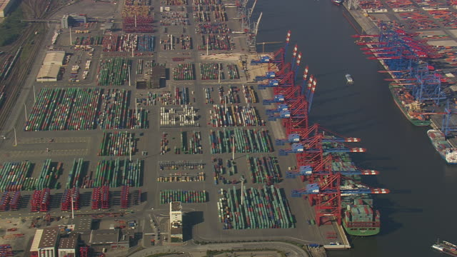 MS AERIAL Shot of container yard with ship in port at Hamburg / Germany