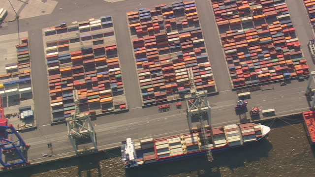 MS AERIAL Shot of container yard with ships in port at Hamburg / Germany