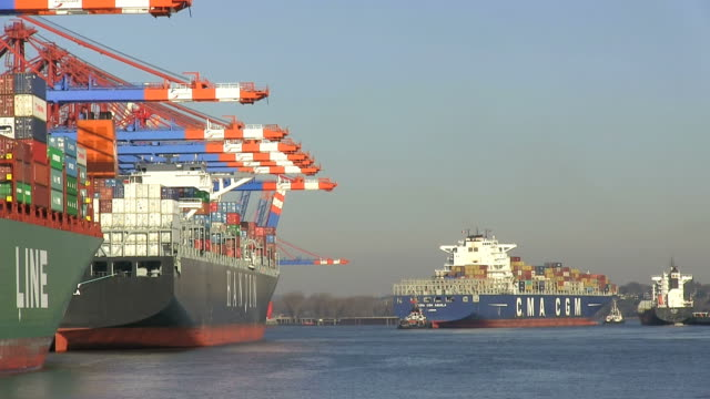 MS Shot of containerships at container terminal Eurokai / Hamburg, Germany