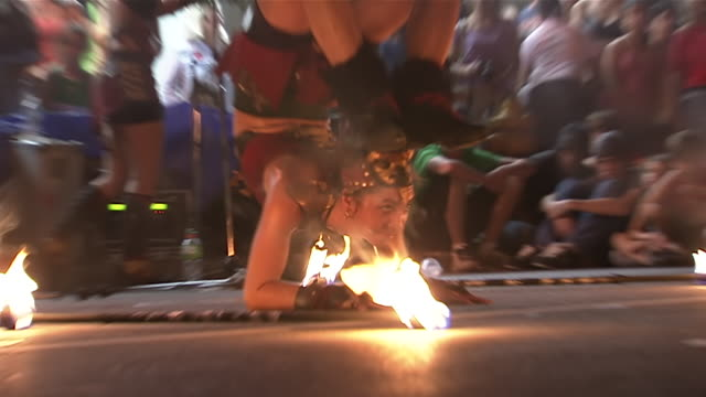 cu la zo tu shot of contortionist performing inside circle of fire at busker fest / toronto, ontario, canada - street performer stock videos and b-roll footage