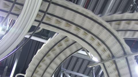 stockvideo's en b-roll-footage met cu shot of conveyer belts at newspaper printing office / russelheim, hesse, germany - krant