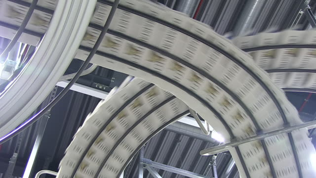 cu shot of conveyer belts at newspaper printing office / russelheim, hesse, germany - druckmaschine stock-videos und b-roll-filmmaterial