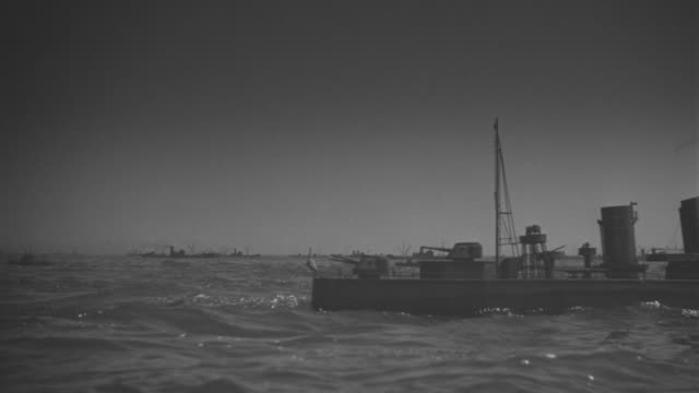 ms shot of convoy of battleships traveling in distance at atlantic ocean - warship stock videos & royalty-free footage