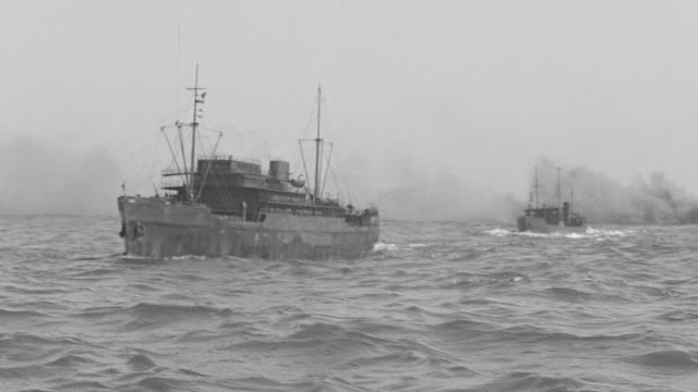 ws shot of convoy of ships in ocean under attack as shells fall from sky - warner bros stock videos & royalty-free footage