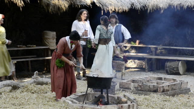 ms shot of cooking in camp life at medieval party showing marriage of 1475 with medieval clothing/ landshut, bavaria, germany - medieval stock videos and b-roll footage