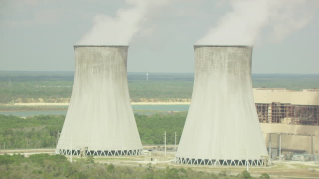 MS AERIAL ZO Shot of cooling towers and Crystal River Power Plant / Crystal River, Florida, United States