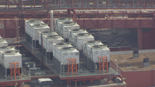 MS AERIAL TS Shot of Cooling towers at Anheuser Busch brewery / St Louis, Missouri, United States