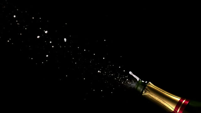 vidéos et rushes de cu slo mo shot of cork popping out of champagne bottle / calvados, normandy, france - champagne