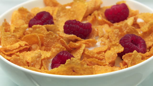 cu shot of cornflakes in bowl - breakfast cereal stock videos and b-roll footage