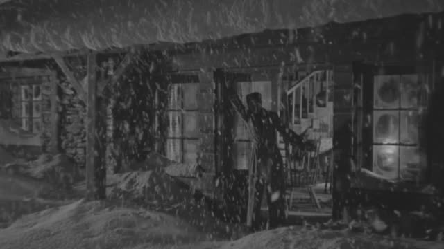 ms shot of couple coming out from house and waiting for some one during falling snow - ranch house stock videos & royalty-free footage
