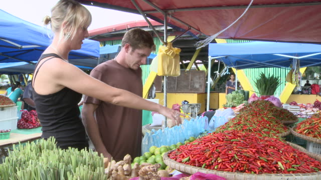 MS Shot of Couple in market with chillis / Kota Kinabalu, Sabah, Malaysia